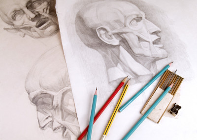 Sketches of human head and pencils